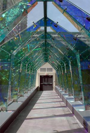 Decorative Glass Pedestrian Bridge Creates Dramatic Arena