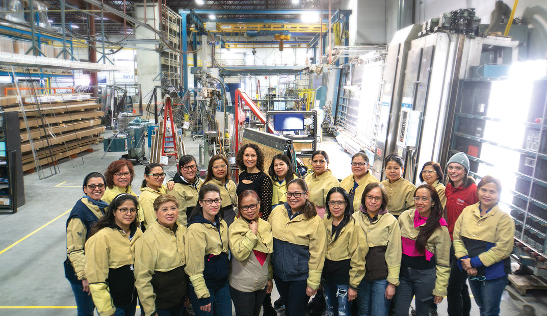 Gemma Martini, CEO of Vitrum Glass Group, with the all-women Insulating Glass Unit assembly team.